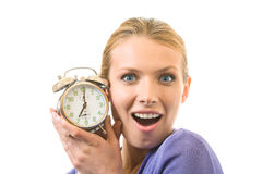 Woman with alarm-clock Stock Image