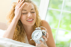 Woman with alarm-clock Royalty Free Stock Photography