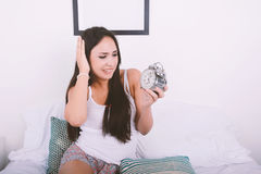Woman with alarm clock. Royalty Free Stock Image