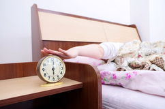 Woman and alarm clock Royalty Free Stock Photo