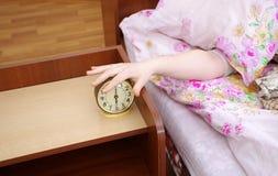 Woman and alarm clock Stock Photo