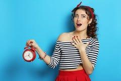 Woman with an alarm clock stock photos