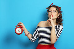 Woman with an alarm clock royalty free stock photography