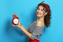 Woman with an alarm clock royalty free stock photo