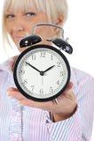 Woman with an alarm clock in a hand. Royalty Free Stock Photography