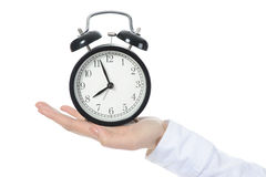 Woman with an alarm clock in a hand. Stock Photography
