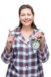 A woman with an alarm clock in her hand at 7 o& x27;clock Royalty Free Stock Image