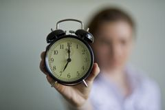Woman and alarm clock Stock Photography