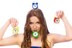 Woman with alarm clocks Stock Photo