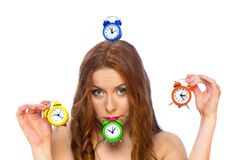 Woman with alarm clocks Royalty Free Stock Photo