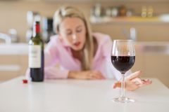Woman with alcohol addiction problem. Young woman with alcohol addiction problem stock photos