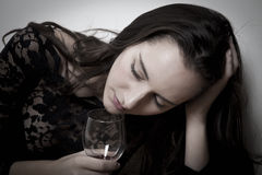 Woman with alcohol. Woman alcohol portrait, holding glass with dejected expression Stock Images