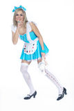 Woman in alice costume Royalty Free Stock Photography