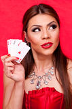Woman with all aces in her hand Stock Images