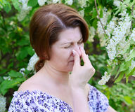 Woman with allergic rhinitis about bird cherry blossoms Stock Images
