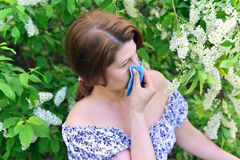 Woman with allergic rhinitis about bird cherry blossoms Royalty Free Stock Photos