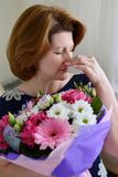 Woman with allergic rhinitis is holding a bouquet  flowers Stock Photography