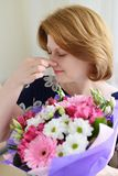Woman with allergic rhinitis is holding a bouquet  flowers Royalty Free Stock Photos