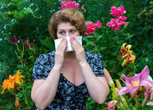 Woman with allergic rhinitis by pollen Royalty Free Stock Photo
