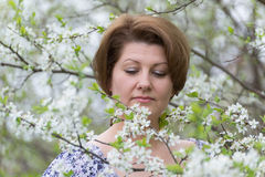 Woman with allergic rhinitis in  spring garden Royalty Free Stock Images