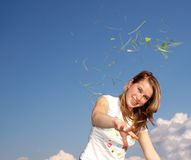 Woman Allergies. Photo of a woman...throw with grass and trefoil Stock Photo