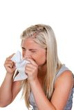 Woman with allergy and hay fever. Woman with allergies, hay fever and handkerchief Royalty Free Stock Images
