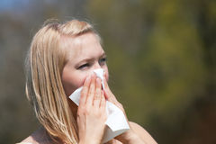 Woman with allergy sneezing Royalty Free Stock Images