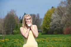 Woman with allergy sneezing Royalty Free Stock Image
