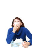 Woman with an allergy sneezing into tissue Royalty Free Stock Photos