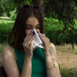 Young pretty woman, allergy, warm weather. Woman allergy young nose sneeze flu pretty Royalty Free Stock Photos