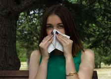 Young pretty woman, allergy, warm weather. Woman allergy young nose sneeze flu pretty Royalty Free Stock Images