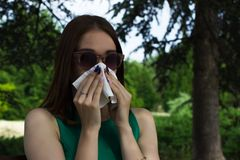Young pretty woman, allergy, warm weather. Woman allergy young nose sneeze flu pretty Royalty Free Stock Image