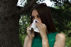 Young pretty woman, allergy, warm weather. Woman allergy young nose sneeze flu pretty Stock Photography