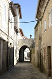 Woman in an alley. With a Small arch of Tui, a town of the province of Pontevedra, in Galicia, Spain Stock Images