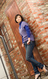 Woman alone. Attractive woman stand alone with old wall Royalty Free Stock Images