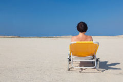 Woman alone on the beach 2. Stock Photography