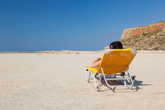 Woman alone on the beach. Royalty Free Stock Photos