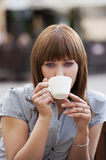 Woman alone drinking a cup of tea Royalty Free Stock Photography