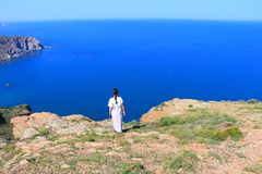Woman alone facing the Mediterranean Sea, France. Woman alone facing the Mediterranean Sea, Pyrenees orientales in southern of France stock photos