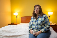 Woman Alone In Hotel Room Stock Photos