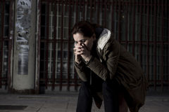 Free Woman Alone In The Street Suffering Depression Looking Sad Desperate And Helpless Sitting Lonely In Dirty Dark Urban Background Stock Photos - 62844093