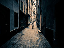 Woman alone in an old street. Woman walking in a street of an old city Royalty Free Stock Photography