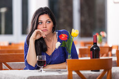 Woman Alone at Restaurant Stock Images