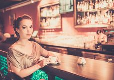 Woman alone in a restaurant Stock Photography