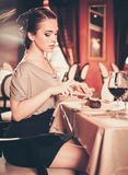 Woman alone in a restaurant Stock Photo