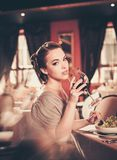 Woman alone in a restaurant Royalty Free Stock Photo