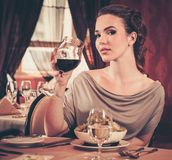 Woman alone in a restaurant Stock Photos