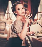 Woman alone in a restaurant Stock Images