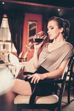 Woman alone in a restaurant Royalty Free Stock Photography