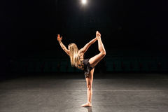 Woman alone on stage doing modern dance performance Royalty Free Stock Image